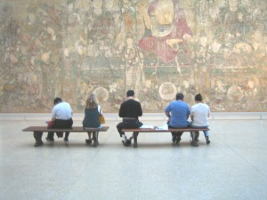 People appreciating a painting at the Met